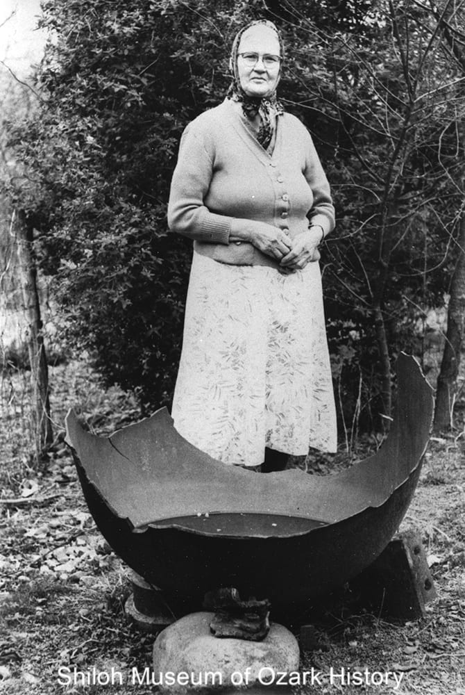 Susie Villines with a kettle from the saltpeter works at Bat Cave, Boxley Valley, Newton County, Arkansas,about 1960.