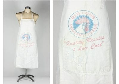 Apron made from a Red Comb Poultry Feeds feed sack (a cloth bag used to hold dry food for chickens) and mended at a later date, probably by Gertrude Pond of Fayetteville, mid 1900s.