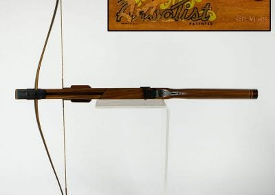 Handmade crossbow made by George Stevens, 1960s, with close-up of manufacturer's label.