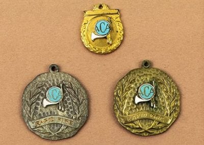 Patsy Laird's crossbow competition medals, 1960-1970