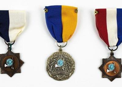 Crossbow Tournament medals won by Arlis Coger, 1970s.