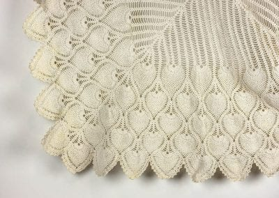 Tablecloth crocheted with cotton string used to close feed sacks.