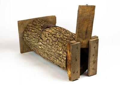 Rabbit trap made from a log.