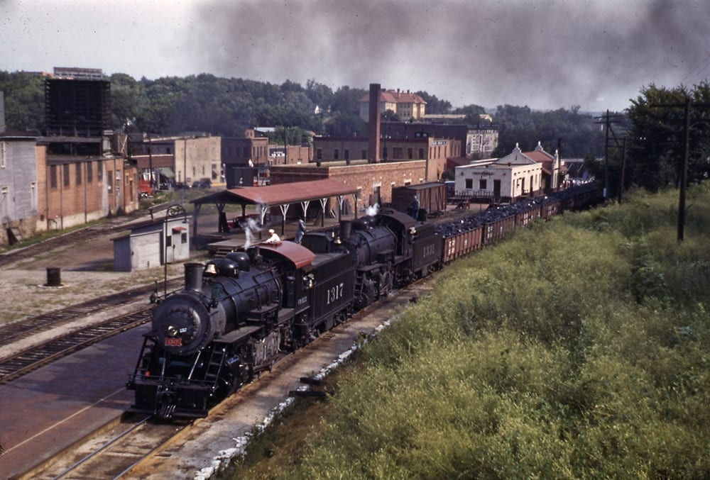 Hauling coal through Fayetteville on the Frisco Railroad, 1940.