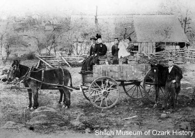 The Hernando A. G. Smith family with their farm wagon, Huntsville area (Madison County,Arkansas), 1890s