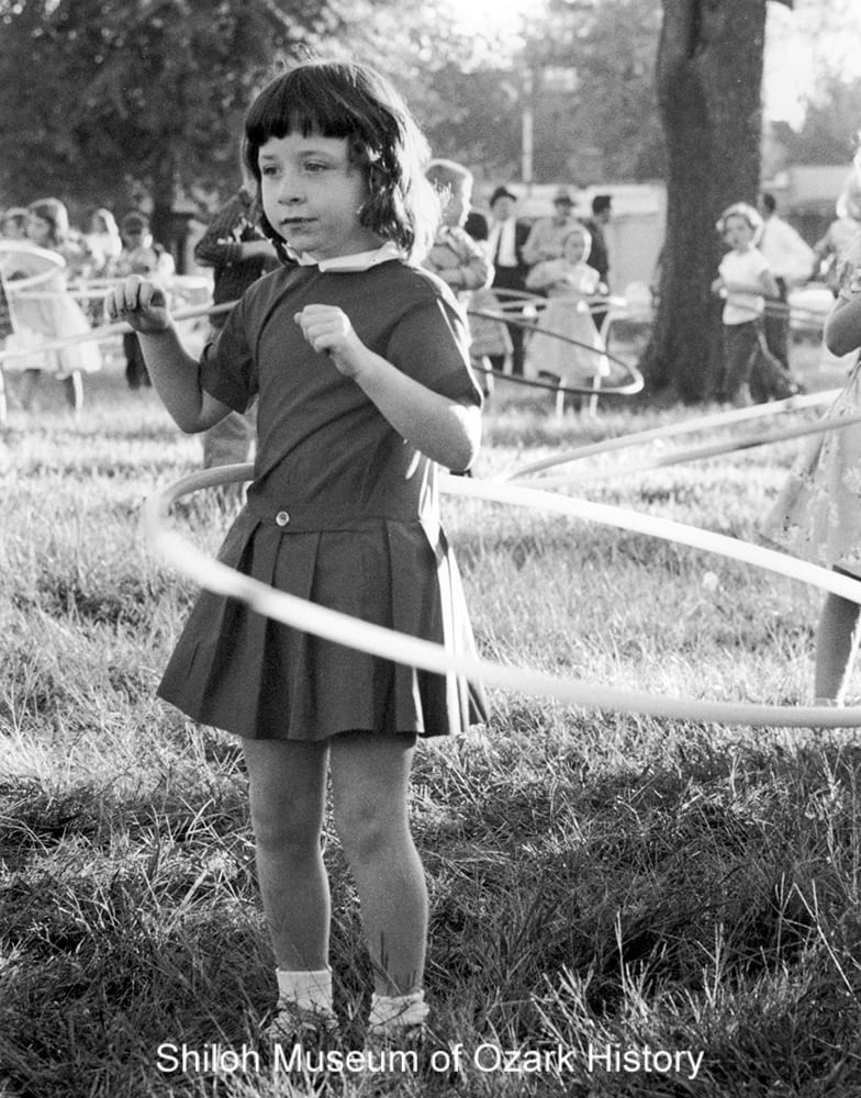 Unidentified girl at a hula hoop contest, Springdale, Arkansas, October 1958.
