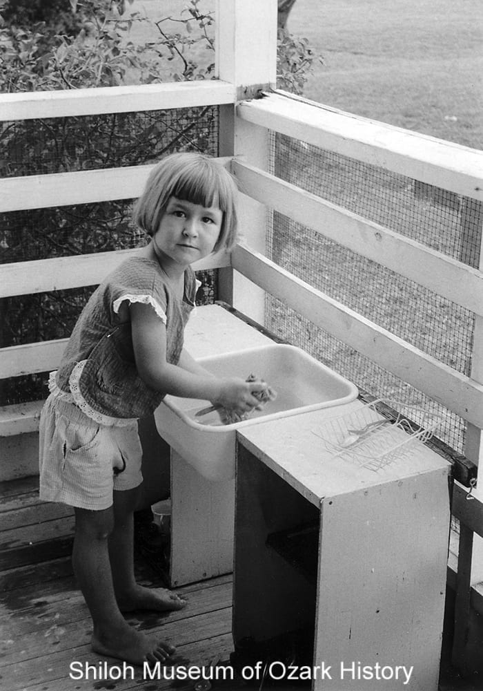 "Unidentified girl ""washing dishes,"" Springdale, Arkansas,1957."