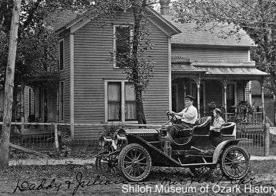 William Garland Ownbey and his son Julian with the family's first automobile, Springdale, Arkansas, 1909.