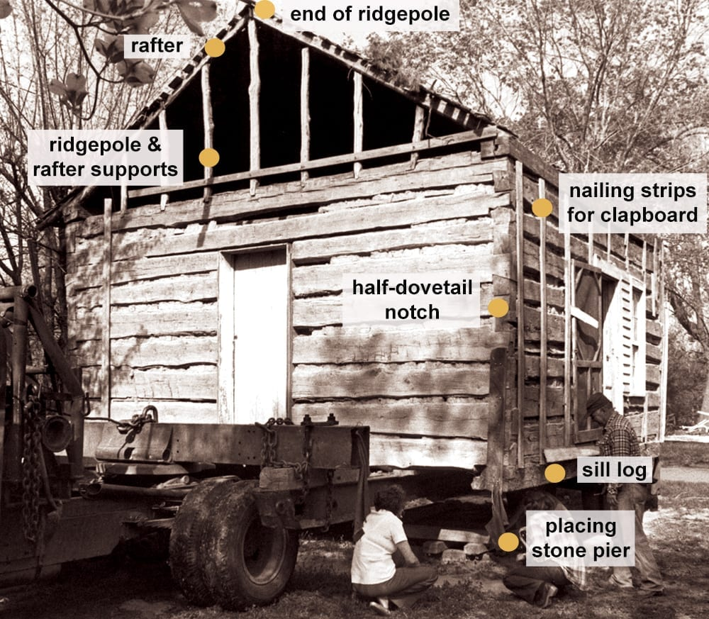 Moving the 1850s Ritter log cabin onto the grounds of the Shiloh Museum of Ozark History, Springdale, Arkansas, April 22, 1980.