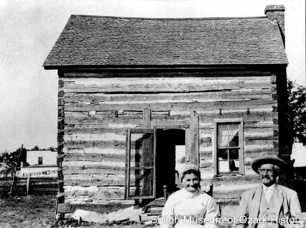 Melania and Pier Antonio Maestri at their single pen log cabin, Tontitown (Washington County, Arkansas), about 1900.