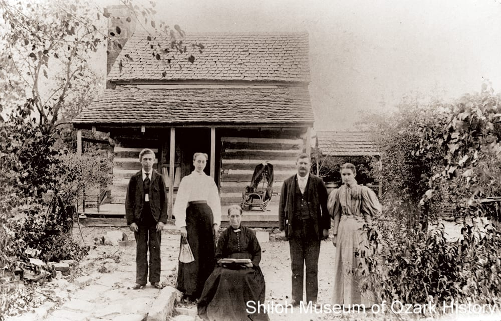 The Fincher family by their single pen log cabin, near Maguiretown  (Washington County, Arkansas), mid 1890s.