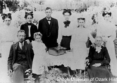 The Alex Stockburger family with their Bible, Greenland area, (Washington County,Arkansas), 1910s.