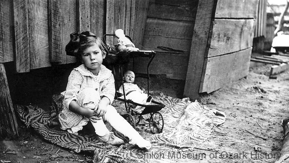 Unidentified girl with dolls, Northwest Arkansas, circa 1910.