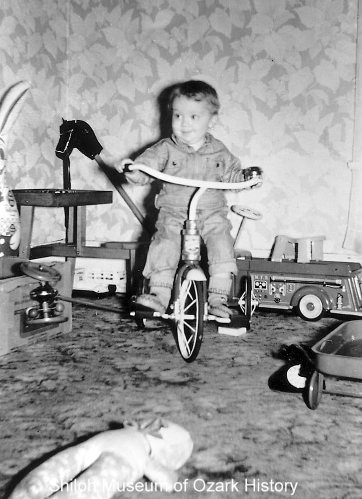 Jimmy Parson with toys, Carroll County, Arkansas, 1950s.