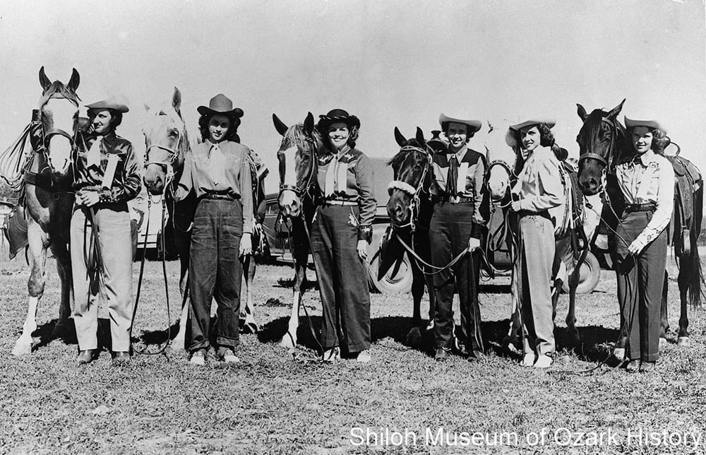 Rodeo queens including Pat Locke, Miss Rodeo of the Ozarks 1949 (3rd from left) and Pat Parsons, Miss Rodeo of the Ozarks 1950 (far right), Parsons Stadium, Springdale, Arkansas, July 1951.