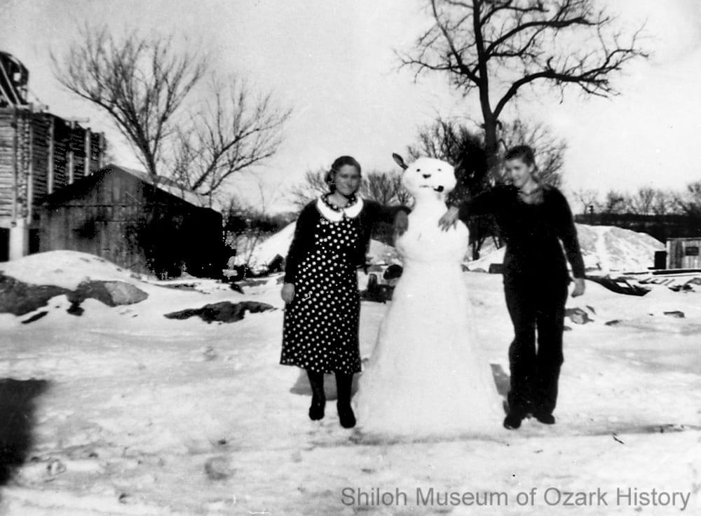 Unidentified women with their snowman, Northwest Arkansas, 1930s.