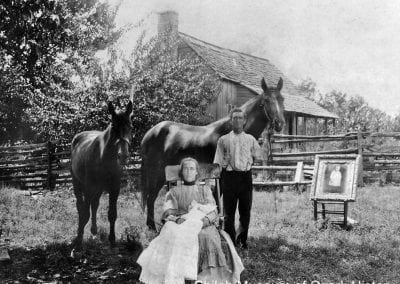 The Clarence Collins family with their horses and framed portrait of their deceased son, Alvie, Boone County, Arkansas, circa 1908.