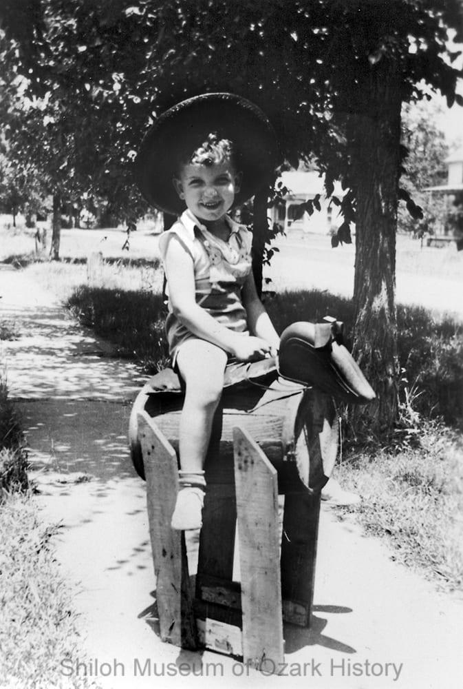 Railey Steele on a homemade barrel pony, Gravette, Arkansas, July 4, 1938.