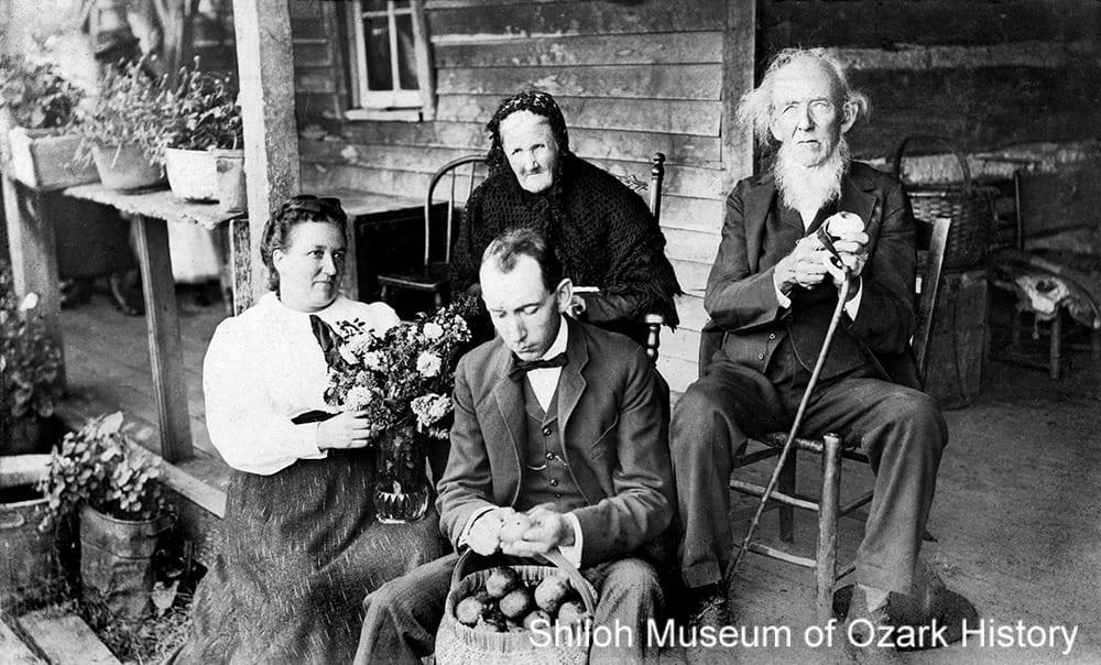 The John Calvin Stockburger family peeling apples, Winslow (Washington County, Arkansas), 1905.