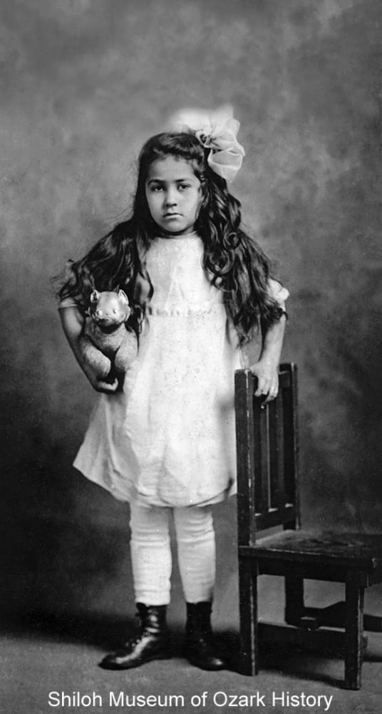 Melba Young of Fayetteville, Arkansas, with her toy, 1910s.