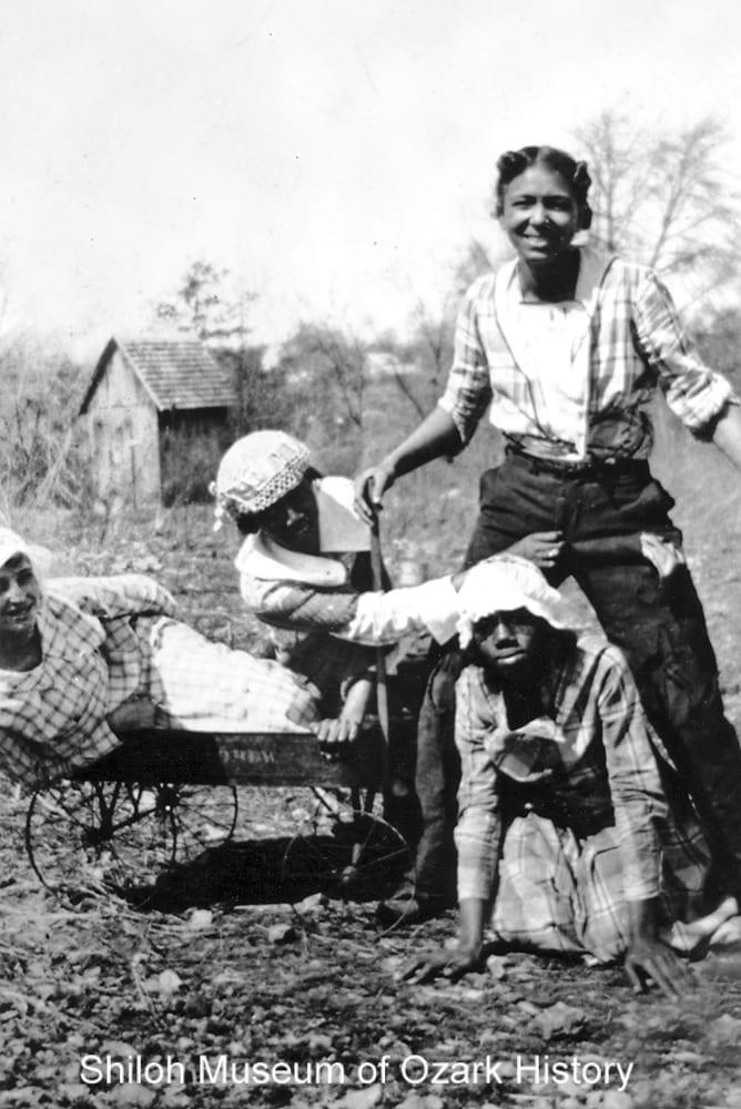 Girls clowning around, Bentonville, Arkansas, 1920s.