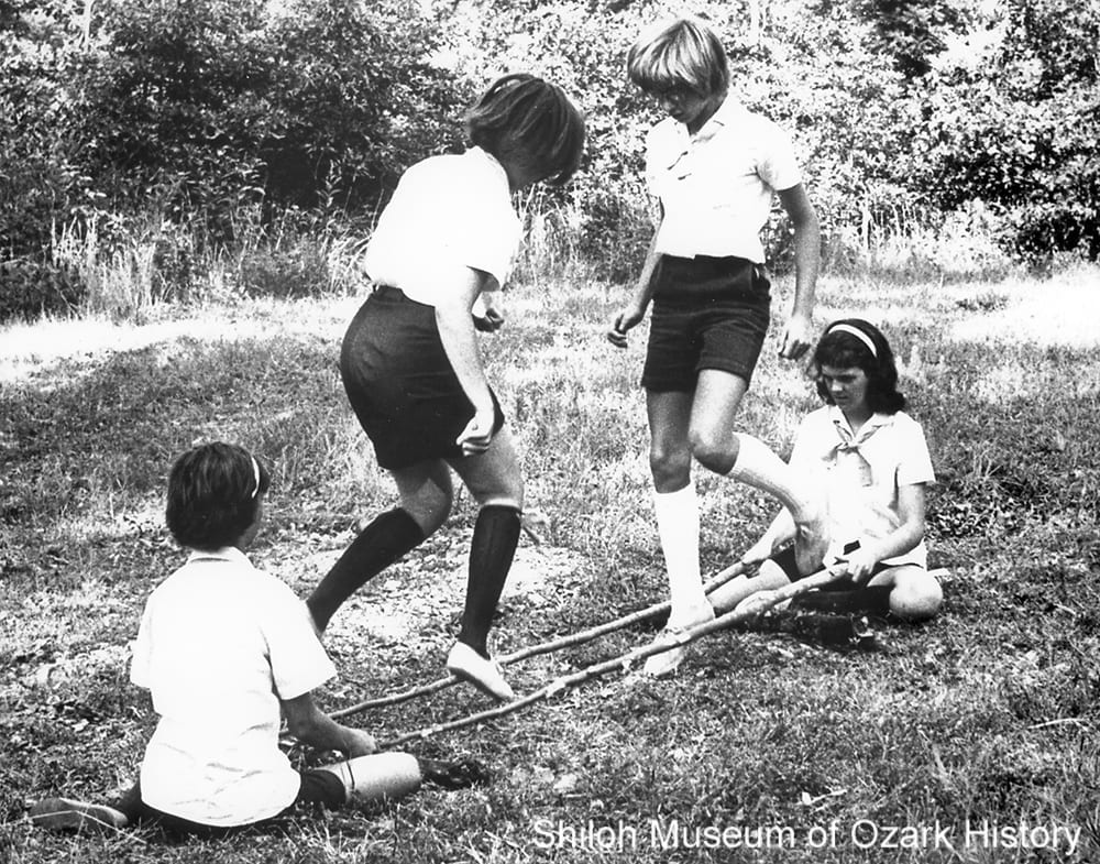 Northwest Arkansas Girl Scouts play tinikling, Bull Shoals State Park, Mountain Home, Arkansas, 1966.