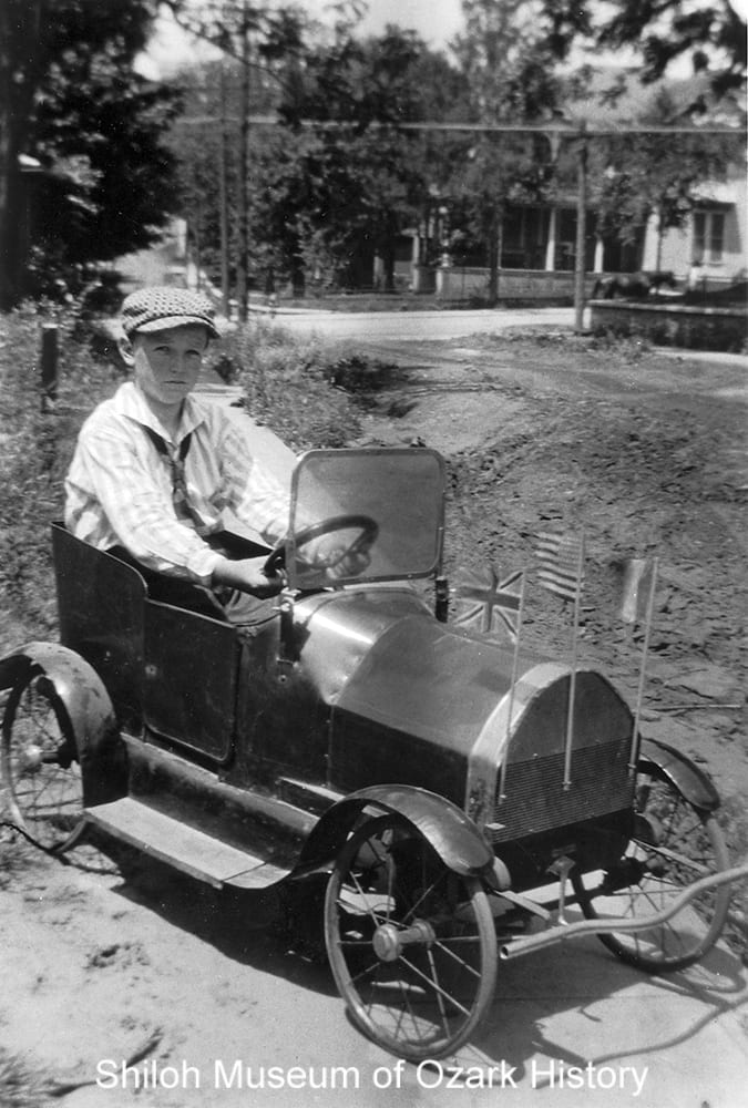 Unidentified boy in a pedal car, Fayetteville, Arkansas, circa 1923.