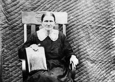 Lucinda Muncie Ogden with her family Bible, Madison County, Arkansas, circa 1910.