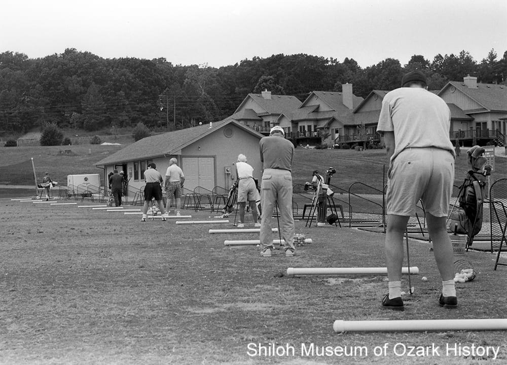 Golfers practicing their drives, Bella Vista, Arkansas, 1990s.