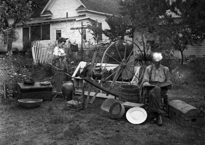 Ewing A. Webb and his grandson Bobby Earl Stewart with their Webb family heirlooms, Fayetteville, Arkansas, 1941.