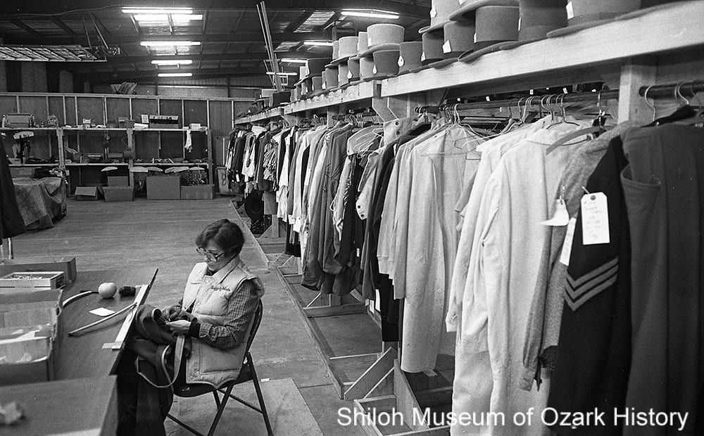 Seamstress at Columbia Pictures' warehouse for The Blue and the Gray, Springdale, Arkansas, 1981