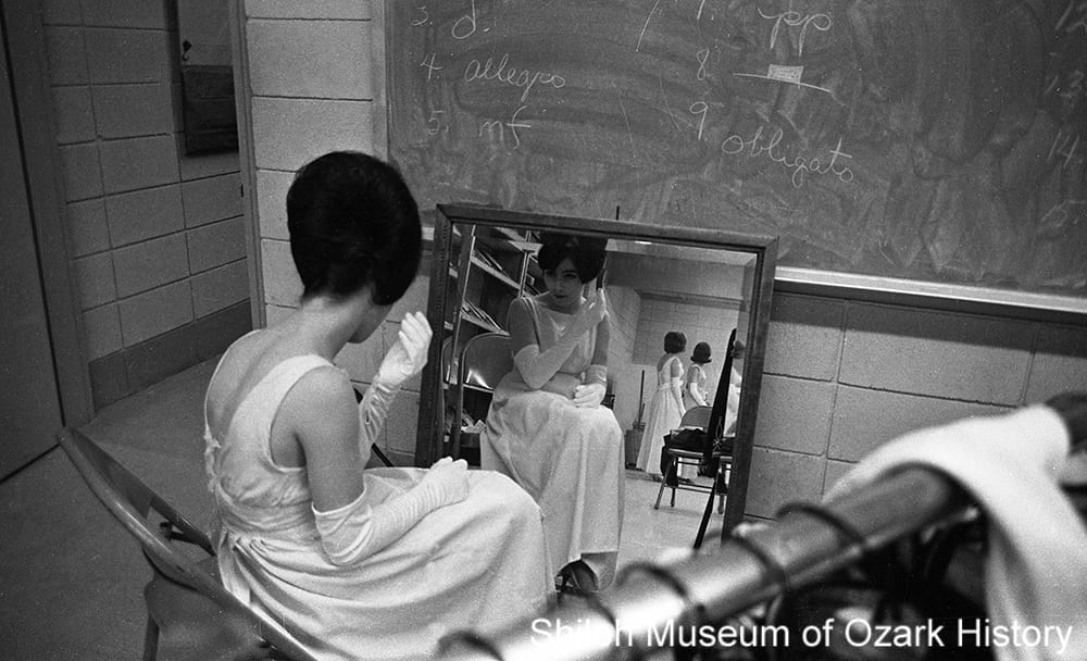 A Miss Huntsville High School contestant checks her hairdo before the pageant, Huntsville, Arkansas, March 4, 1963.