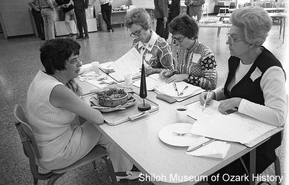 A Chicken Cookin' contestant tells the judges about her entry, Springdale High School, Springdale, Arkansas, April 21, 1973.