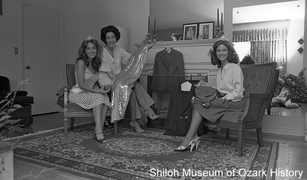 DeanE Walker (center) reviews pageant clothes with contestants getting ready for the Miss Arkansas 1980 pageant, Springdale, Arkansas, June 26, 1980.