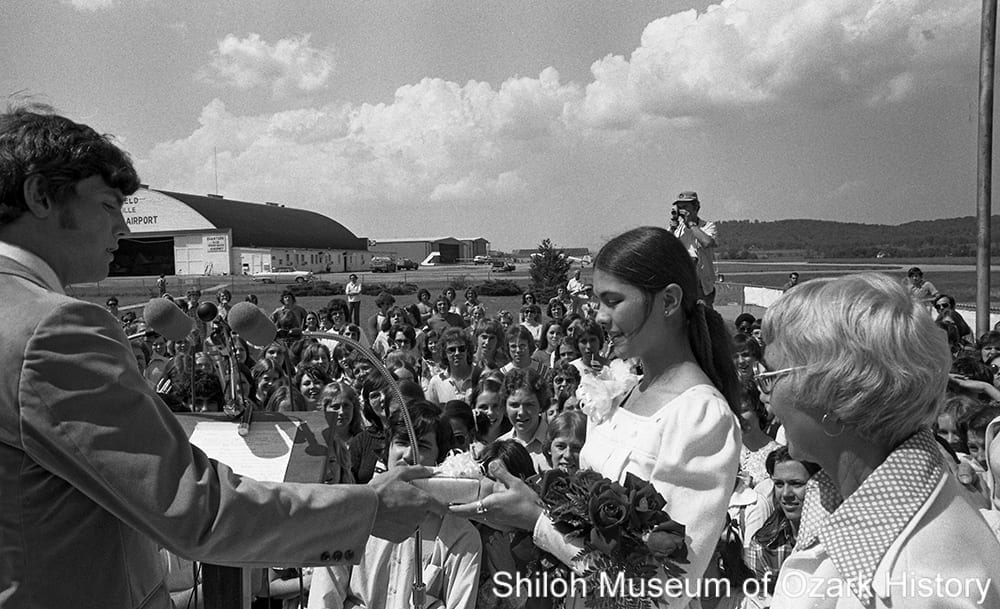 Julie Ann Forshee of Fayetteville receives gifts from well wishers upon her return home after winning the American Junior Miss 1975 title, Drake Field, Fayetteville, May 7, 1975.
