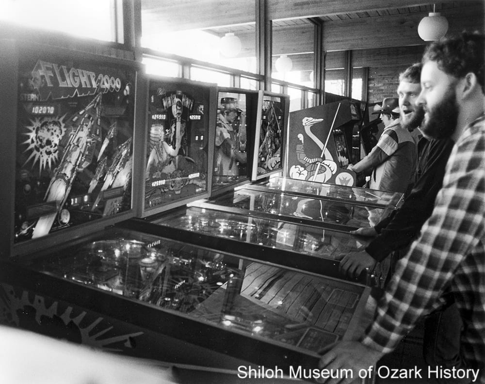 Pinball players and videogamers at Hog Heaven, Springdale, Arkansas, December 30, 1982.