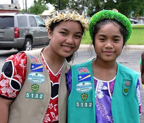 Jemenei Day—Tabitha Kerong (left) wears a traditional wut (headband) while her sister Anna wears a modern adaptation, May 2016.