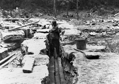 H. Sartin building the dam, Devil's Den CCC camp,1930s