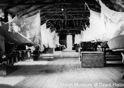 Barracks with cots at Devil's Den CCC camp, 1930s.