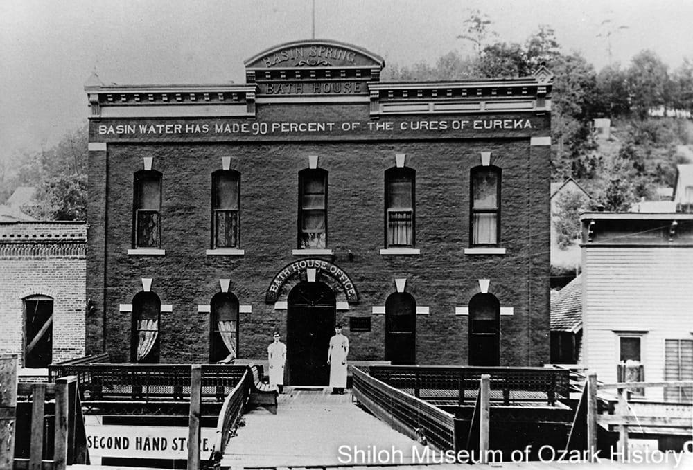 Basin Spring Bath House with attendants, Eureka Springs, Arkansas, 1903.