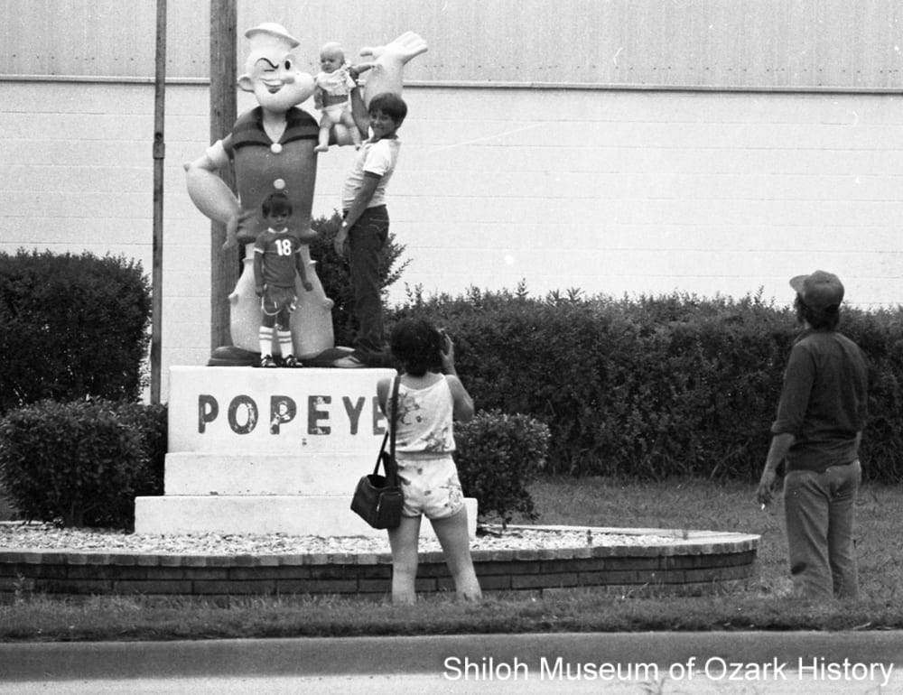 Children pose with the Popeye statue, Allen Canning Company, Springdale, Arkansas, June 18, 1980.