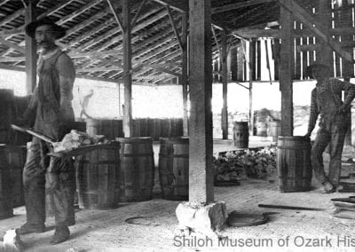 Workers on the cooling floor, shoveling quicklime into barrels, Ozark White Lime Company, Johnson, Arkansas, circa 1908.