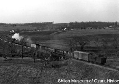 "View from ""Limekiln Bluff"" of a Frisco Railroad train crossing the Clear Creek trestle, Johnson, Arkansas, circa 1908."