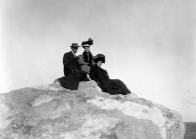 Sightseers on a limestone outcropping, Johnson, Arkansas, circa 1908.