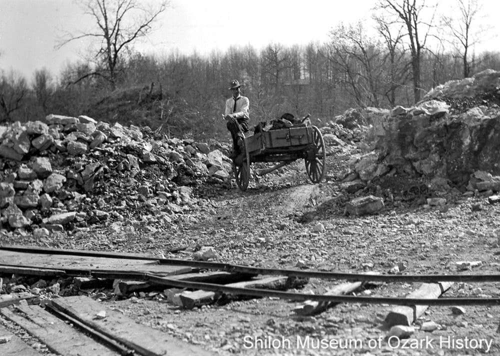Sightseer at the lime quarry, Johnson, Arkansas, circa 1908.