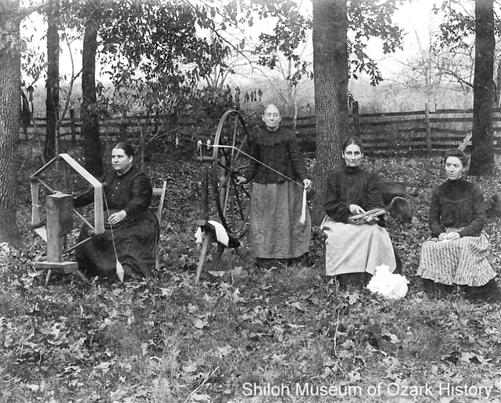 Heagerty family members demonstrating the steps needed to spin cotton, Cave Springs (Benton County, Arkansas), about 1900.