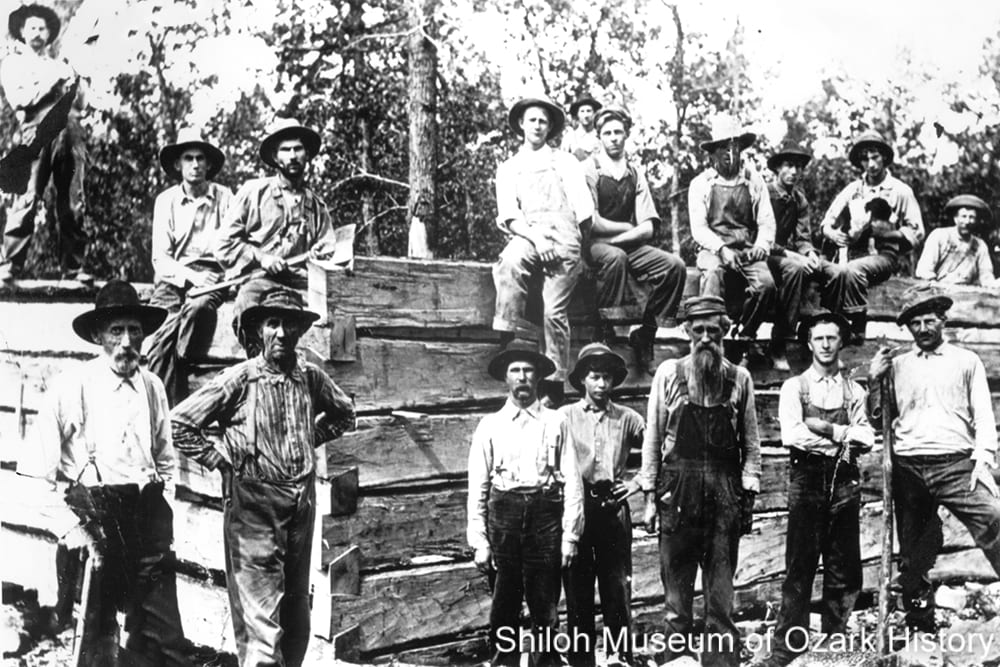 Erwin family members and others building a log cabin, Hilltop Community (Boone County, Arkansas), 1913.