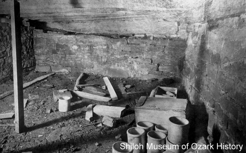 "Abandoned cellar with ""stone jars,"" probably Cane Hill (Washington County), mid 1900s."