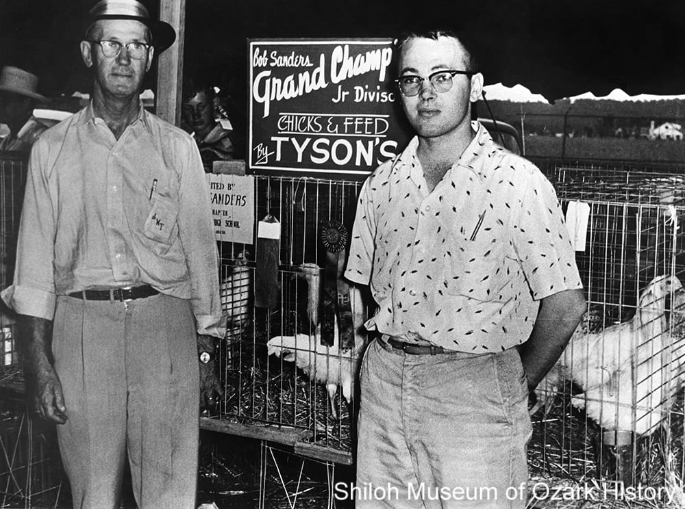 John Tyson (left) and son Don Tyson at the Northwest Arkansas Poultry and Livestock Show, Springdale, Arkansas, 1955.