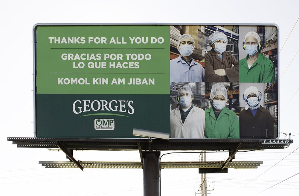 George's Inc. billboard thanking employees in English, Spanish, and Marshallese for their work during the global COVID-19 pandemic, Springdale, Arkansas, November 30, 2020.